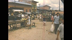 Vintage 16mm film, Amazon basin town market 1960s busy Stock Footage