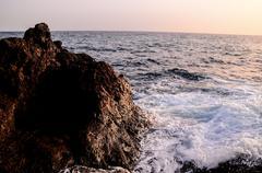 Strong Waves Crashing on the Volcanic Coast Stock Photos