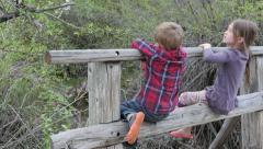 Kids on bridge over stream - stock footage