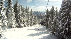 Skier rises on the ski lifts. Around Panorama and landscapes of mountains, snow Stock Footage