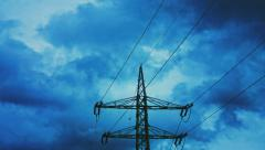 Voltage electricity pylon time-lapse with dark clouds Stock Footage