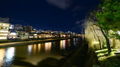 Time Lapse of Historic Kamogawa River in Kyoto at Night -Zoom In- Stock Footage