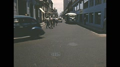 Vintage 16mm film, Amazon basin, traffic in town, old buses and cars, busy 1950s Stock Footage