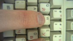 Human fingers typing text on keyboard - stock footage
