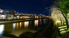 4K Time Lapse of Historic Kamogawa River in Kyoto at Night -Tilt Up- Stock Footage