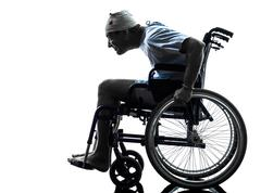 Funny careless injured man in wheelchair silhouette Stock Photos