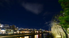 4K Time Lapse of Historic Kamogawa River in Kyoto at Night -Tilt Down- Stock Footage