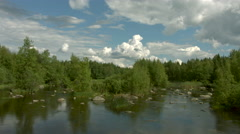 Timelapse of clouds over a river Stock Footage