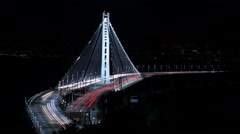 4K SF Bay Bridge Timelapse 01 Night Traffic Pan R and Zoom In Stock Footage