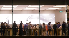 People attend store Apple promotion show room in Hong Kong. Stock Footage