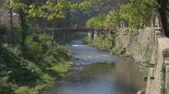 River Cerna bridge   scenery of spa resort Herculane located in  western Roma Stock Footage