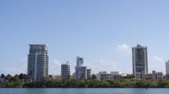 Tilt-down Condado lagoon aparment buildings skyline - cityscape Stock Footage