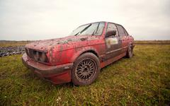 Red sport car stay on the dirt - stock photo
