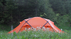 Tent in the woods in the rain Stock Footage