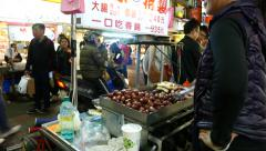 Fresh short chinese sausages booth at night street, cooking selling, Stock Footage