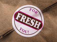 A Bag Of Pastries Or Donuts With Fresh For You Label Stock Photos