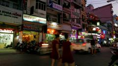 Ho Chi Minh City - April 2015: Backpacker's area street view in the evening. 4K Stock Footage