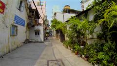 Ho Chi Minh City - April 2015: POV walk in narrow alley in old town. Speed up. Stock Footage