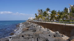 Condado waterfront breakwater cement boardwalk - seawalk - sea observation deck. - stock footage