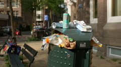 Full trash can on street Stock Footage