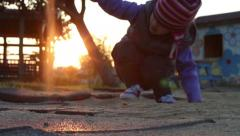 Little girl playing in sandpit at the sunset time 5 - Model Release Stock Footage