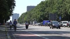 ULTRA HD 4K Traffic street car pass people enjoy bicycle Berlin travel busy road Stock Footage