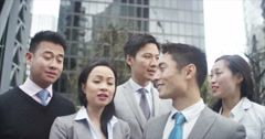 4K Portrait of attractive Asian business team outdoors in city financial distric Stock Footage