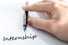 Pen in the hand internship concept - stock photo