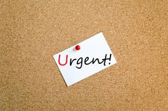 Sticky Note Urgent Concept - stock photo