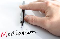 Pen in the hand mediation concept - stock photo