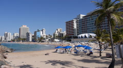 Condado beach front tourist at beach 2 - stock footage