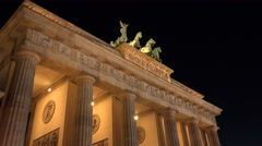 ULTRA HD 4K Famous Brandenburg Gate triumphal arch Berlin landmark night emblem  Stock Footage
