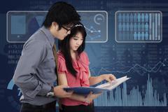 Entrepreneurs and futuristic interface Stock Photos