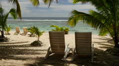 Beach chairs at the beach in Rarotonga, Cook Islands Stock Footage