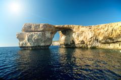Azure Window, famous stone arch on Gozo island with reflection, Malta Stock Photos