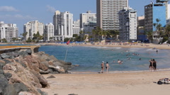 Condado beach front tourist at beach 1 - stock footage