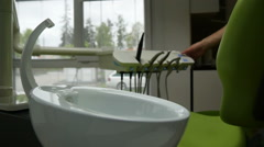 Modern Dentist - Turn on the Water Stock Footage