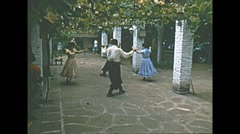 Vintage 16mm film, Brazilian couples dance in courtyard, 1960s Stock Footage
