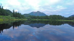 Beautiful Alaskan landscape reflects on surface of lake Stock Footage