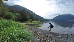 Man hiking coastal northwest wilderness Stock Footage