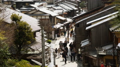 4k Time Lapse of Tourists on Historic Street in Kyoto, Japan -Zoom In- Stock Footage