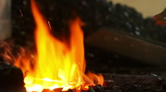 Smith heats a nail in the oven, slow motion Stock Footage