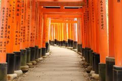 Torii at Fushimi Inari shrine with characters Stock Photos