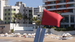 Beach red flag - danger warning advisory Stock Footage