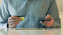 Using Credit Card And Smart-Phone For Online Shopping Stock Footage