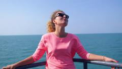 Attractive Girl Enjoying Sunny Day on Yacht Deck in Sea Stock Footage