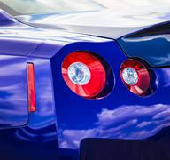 Blue sport car taillight - stock photo