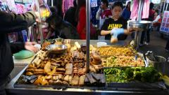 Table full of chinese snacks, market booth, busy street Stock Footage