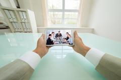 Close-up Of A Businessman Video Chatting With Colleagues On Digital Tablet. P Kuvituskuvat