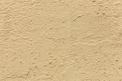 Plaster or cement texture light yellow color - stock photo